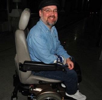 Scott in low-tech wheelchair