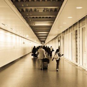 Travelers Walking in Hallway