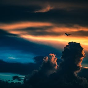 Plane in Cloudy Sunset
