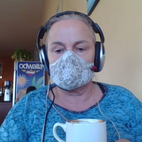 Suki Graves working mask in coffee shop