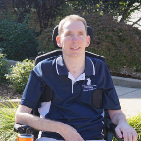 Chad Buder seated in his wheelchair