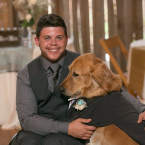 Kade Patterson Posing at a Formal Event with a Dog